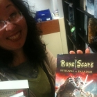 Arc-sama posing with a Runescape book.